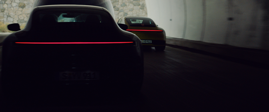 two porsche cars from behind
